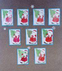 Mikołaj zchoinką pomalowany farbami plakatowymi ipędzlem, broda ikożuszek przy płaszczu wyklejony watą.