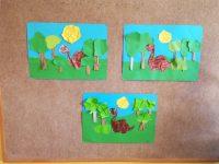 Dinozaur – kolorowanie postaci dinozaura pastelami olejnymi, wycięcie nożyczkami iprzyklejenie napapier formatu A3, naklejenie drzew zwydartego papieru zielonego iszarego