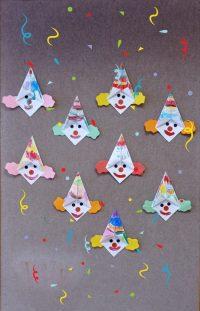 Klown - praca wykonana techniką origami zkwadratu, czapka pomalowana pastelami, włosy wycięte zpapieru kolorowego, oczy inos zrobione zkółek