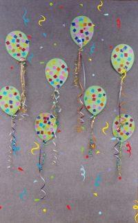 Baloniki wycięte zkartonu, ozdobione kawałkami bibuły