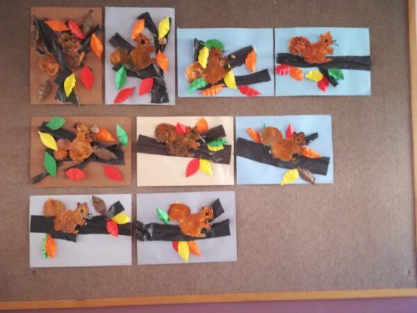 Wiewiórka - praca wykonana zpapieru kolorowego orazpomalowanej iwyciętej postaci wiewiórki